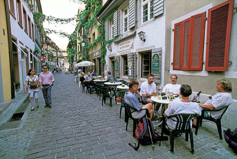 A small outdoor café that fits in a narrow street, Freiburg, Germany